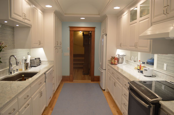 o We enlarged the kitchen for modern living convenience. Opening it to the front entry to improved overall flow and awareness of visitors, yet the new pocket door allows for separation if desired. An open connection to the Family Room was maintained and long diagonal views through the Sun Room to the beautiful back yard.